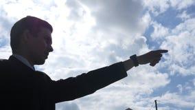 Silhouet van Zakenman Showing Direction, Leider Pointing met Vinger, royalty-vrije stock afbeeldingen