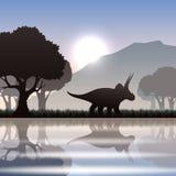 Silhouetdinosaurus in landschap Royalty-vrije Stock Afbeeldingen