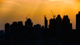 Silhouete city with construction site for background. Royalty Free Stock Photography