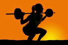 Silhouete of woman deep squat Stock Photos