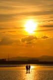 Silhouetfotograaf op het strand Stock Fotografie