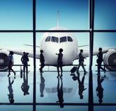 Silhouetgroep Bedrijfsmensen met Vliegtuigconcept Royalty-vrije Stock Afbeeldingen
