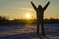 Silhouetmens op zonsopgang Stock Foto