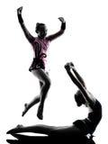 Silhouett del adolescente del niño de la niña de la mujer de la gimnasia rítmica Fotografía de archivo