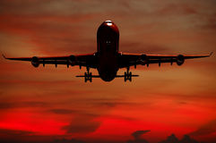 Silhouett of plane and sunset Royalty Free Stock Image