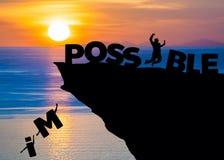 Silhouette бизнесмен скача на пляж моря к слову полного текста возможному на метафоре восхода солнца к успеху, возможности, motiv Стоковые Фото