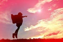 Silhouette девушка на заходе солнца Стоковые Изображения RF