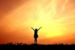 Silhouette рука девушки открытая Стоковое Изображение RF