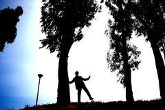 Silhouette. Of boy,trees and lamp Royalty Free Stock Photography
