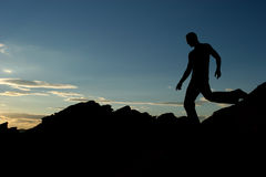 Silhouette. Of a man at sunset Stock Photo
