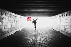 Silhouette. Of a jumping man with umbrella Royalty Free Stock Photos