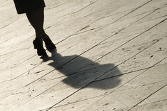 Silhouette. A silhouette of a woman walking stock images