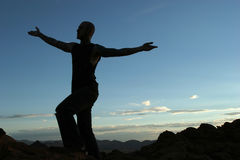 Silhouette. Of a man on mountain top Royalty Free Stock Photography
