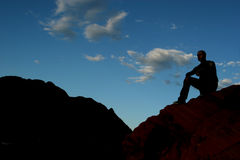 Silhouette. Of a man on mountain top Royalty Free Stock Image