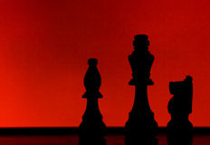 Silhouette of 3 chess pieces Royalty Free Stock Photos