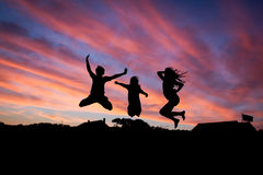 Silhouette of 3 People Jumping Royalty Free Stock Photo