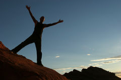 Silhouette. Of a man on mountain top Stock Image