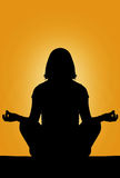 Silhouette. Of a beautiful woman meditating royalty free stock photo