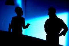 Silhouette. Of the two people chating Royalty Free Stock Images