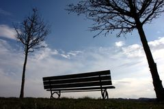 Silhouette. Of a park bench at sunset Royalty Free Stock Images