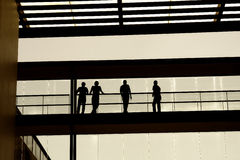 Silhouette. People inside the modern building, students in silhouette Royalty Free Stock Image