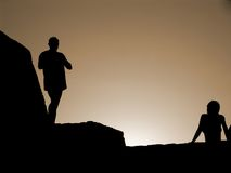 Silhouette. People silhouetted on mountain at sunset Royalty Free Stock Photo