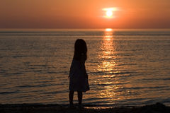 Silhouette. Silhouette of cute girl at beach at sunset Royalty Free Stock Photography