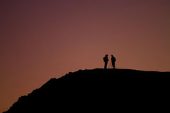 Silhouette. Photographers in the mount in Sinay stock photos