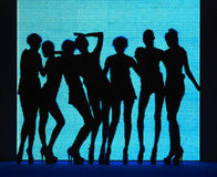 Silhouette 7 women with blue background Royalty Free Stock Images