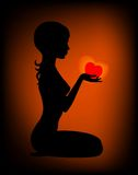 Silhouette. Of the beautiful girl with heart in hands Royalty Free Illustration