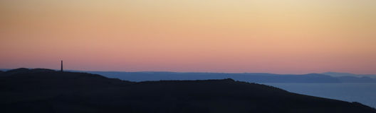 Silhouette of Aberystwyth hills at sunset Royalty Free Stock Image