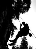 Silhouette of abseiler. On rock face Stock Photo
