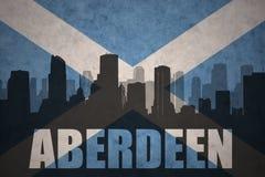 Silhouette abstraite de la ville avec le texte Aberdeen au drapeau de l'Ecosse de vintage Images libres de droits