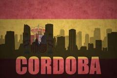 Silhouette abstraite de la ville avec le texte Cordoue au drapeau d'Espagnol de vintage Photos libres de droits