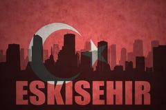 Silhouette abstraite de la ville avec le texte Eskisehir au drapeau de turc de vintage Photos libres de droits