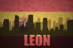 Silhouette abstraite de la ville avec le texte Léon au drapeau d'Espagnol de vintage Photographie stock libre de droits