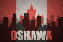 Silhouette abstraite de la ville avec le texte Oshawa au drapeau de Canadien de vintage image stock