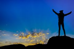 Silhouette achievements successful arm up girl is on top of hill celebrating success with sunset. Silhouette achievements successful arm up girl is on top of Stock Image
