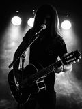 Silhouette acoustic guitar player on stage Stock Photo