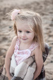 Silhouette of adorable little girl on a beach at. Sunset. This image has attached release Stock Photography