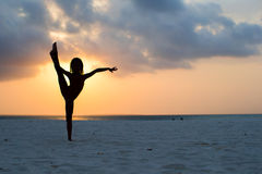 Silhouette of adorable little girl on white beach at sunset Royalty Free Stock Photos