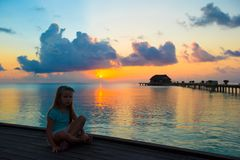 Silhouette of adorable little girl on wooden jetty Royalty Free Stock Image