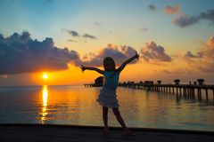 Silhouette of adorable little girl on wooden jetty Stock Photography