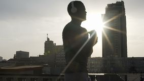 Silhouette of adult fighter warming up before match in rays of sun, motivation stock video