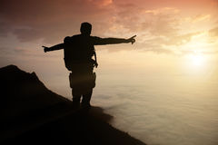 Silhouette adventurer team on the mountain and sunrise. Concept business success Stock Image