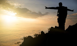 Silhouette adventurer team on the mountain and sunrise. Concept business success Royalty Free Stock Photography