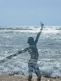 Silhouette of an Afro boy at the beach. Silhouette of an Afro boy at the  beach Stock Photos