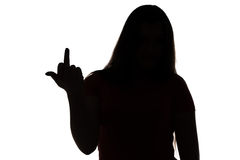 Silhouette of aggressive teenage girl Royalty Free Stock Image