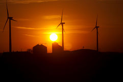 Silhouette of agriculture and wind farm Royalty Free Stock Photography