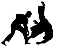 Silhouette of Aikido masters, leading the fight in training.  Royalty Free Stock Photography